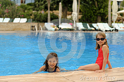 Young girls at edge of pool