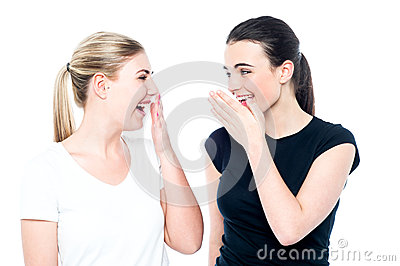 Young girls gossiping and having fun