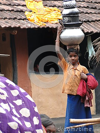 Young girls learn to carry water Editorial Stock Photo