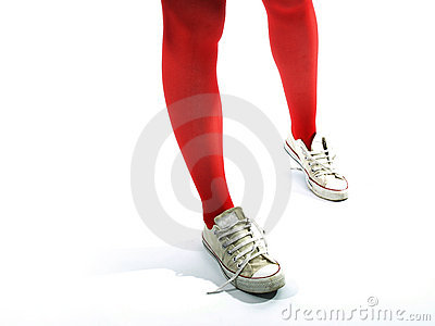 Young girls legs in red tights and old sneakers