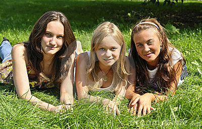 Young Girls Lying On The Grass Royalty Free Stock Photo - Image: 3013475