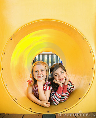 Young Girls Lying Together in Crawl Tube