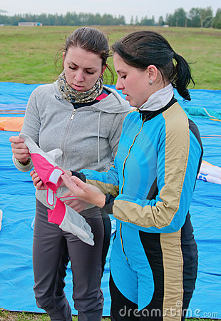 Young girls-parachutists examine gloves