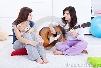 Young girls relaxing and talking