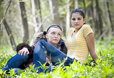 Young girls resting in forest