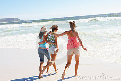 Young girls running on the beach