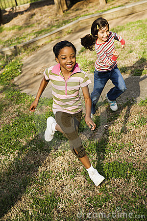 Young Girls Running on Grass