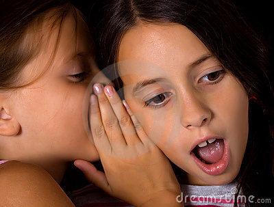 Young girls sharing a secret