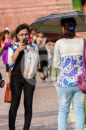 Free Young Girls Taking Photographs With Mobile Phone Stock Photo - 110367000