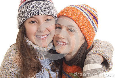 Young girls in warm winter clothes hugging