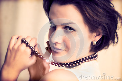 Young glamour lady with necklace