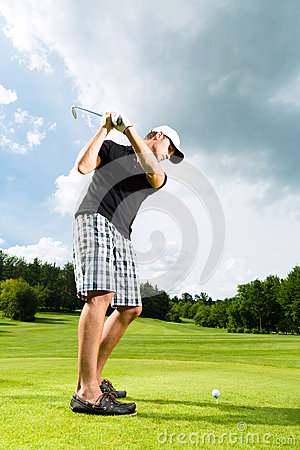 Free Young Golf Player On Course Doing Golf Swing Royalty Free Stock Photos - 26869278