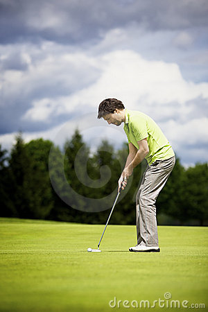 Young golf player putting.