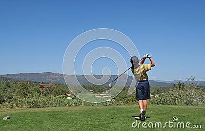Young golfer hitting a golf shot