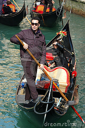 Young gondolier taking japanese tourists on Venice Editorial Stock Photo