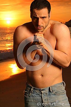 Young goodlooking man at the beach