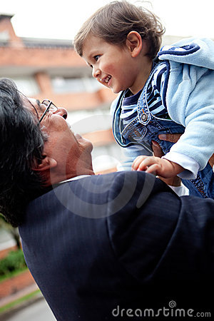 Young grandfather with a child