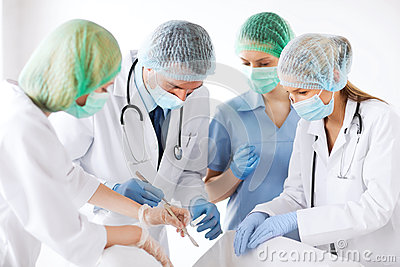Young group of doctors doing operation