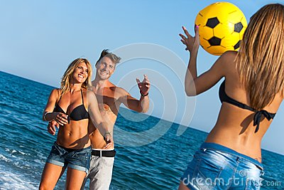 Young group of friends having fun with ball game.