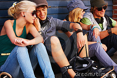 Young group of people sitting together having fun
