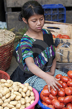 Young Guatemalan woman selling vegetables