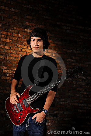 Free Young Guitarist Royalty Free Stock Photography - 22151097