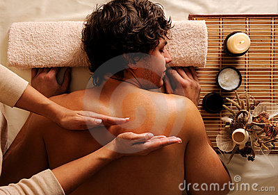 Young guy in a beauty salon getting massage