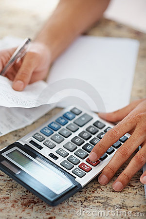 Young guy calculation with focus on calculator