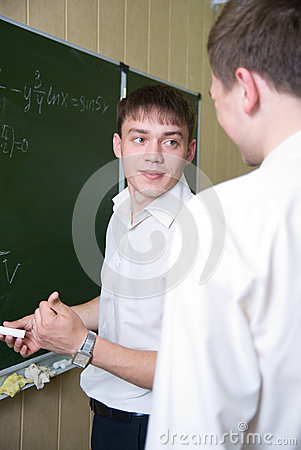 Young guy with chalk in a hand