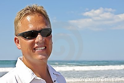 Young guy enjoying holidays at the beach
