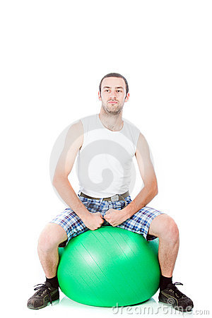 Young guy on a exercise ball