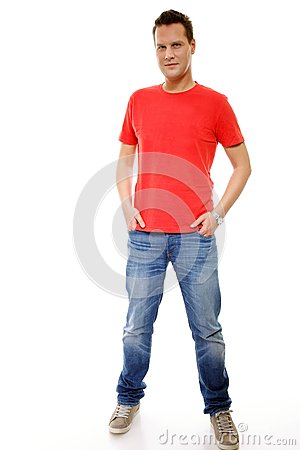 Young guy with hands in pockets isolated Stock Photo