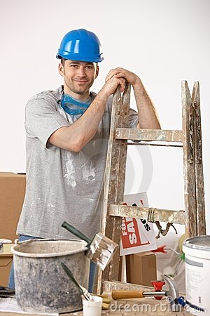 Young guy painting house