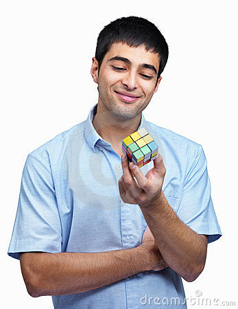 Young guy with a rubic cube thinking of a solution Editorial Photo