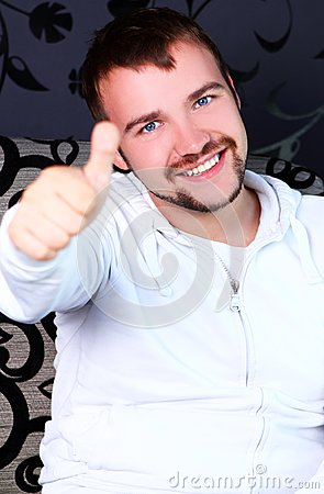 Young guy showing OK sign