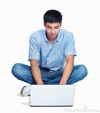Young guy using a laptop isolated