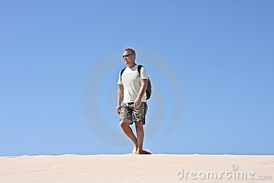 Young guy walking in the desert