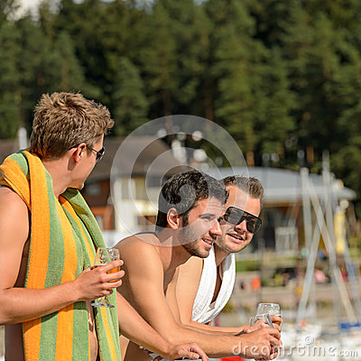 Young guys at beach drinking beer