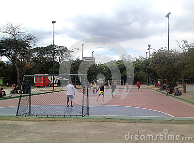 Young guys playing micro soccer in the park Editorial Stock Photo