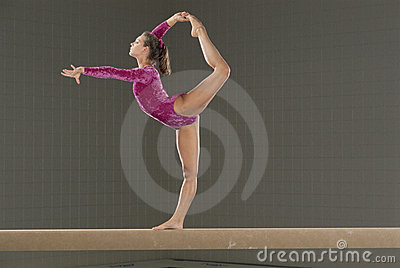 Young gymnast on balance beam