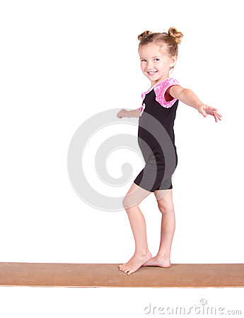 Young Gymnast balances on beam