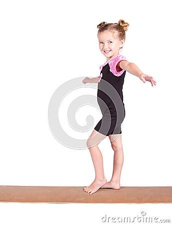 Young Gymnast balances on beam