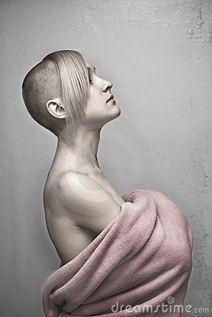Young hairless woman in towel