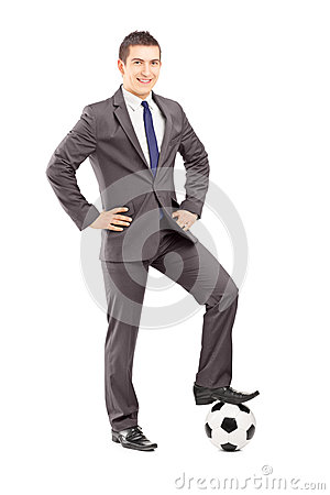 Free Young Handsome Businessman Posing With A Football Royalty Free Stock Image - 32209506