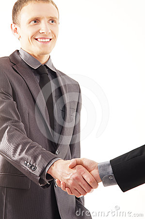 A young and handsome businessman shaking hands