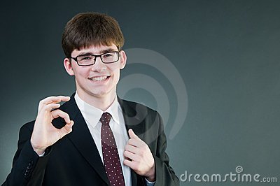 Young handsome businessman showing ok sign