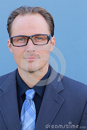 Free Young Handsome Businessman With Glasses Against Blue Background Stock Photography - 80169242
