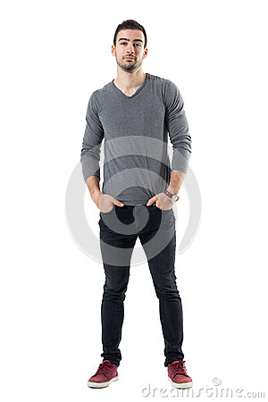Free Young Handsome Fashion Model In Gray Shirt With Hands In Pockets Looking At Camera Royalty Free Stock Images - 91647459