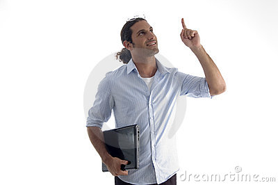 Young handsome guy holding laptop pointing upwards
