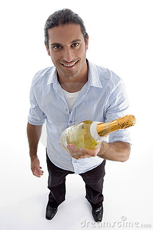 Free Young Handsome Guy Holding Wine Bottle Royalty Free Stock Photography - 7140237